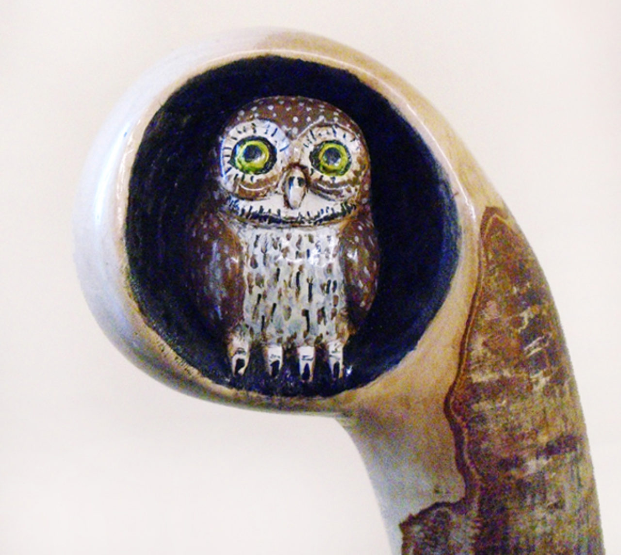 Robert Denton's handmade walking sticks are legendary for their craftsmanship. He takes extreme care with each element of design, as seen in this owl topper.