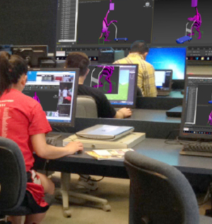 students working on video games in a classroom