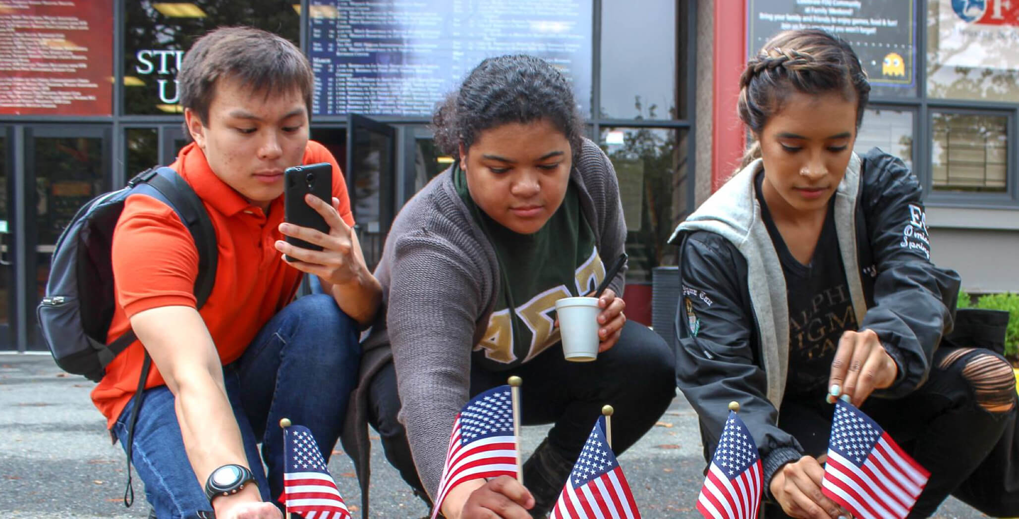 students planting American flags