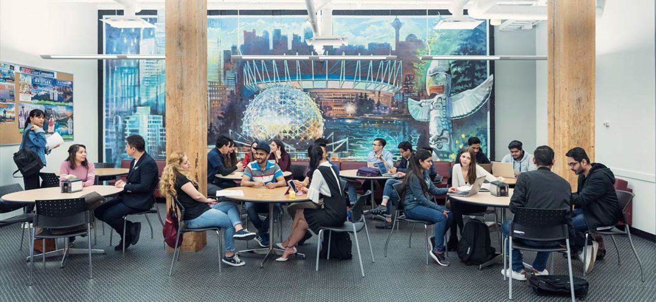 students sitting in a building on vancouver's campus