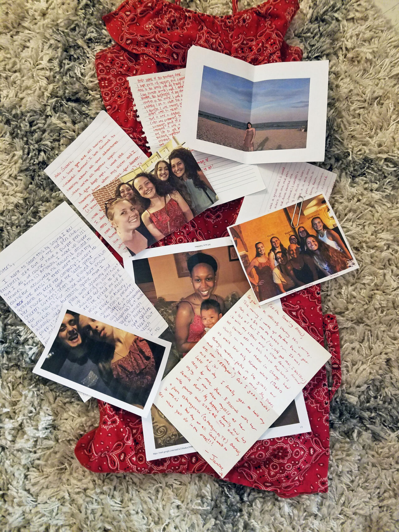 A pile of photos and hand-written notes.
