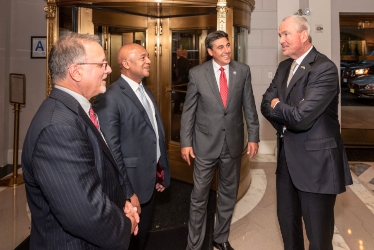 Silberman College of Business Dean Andrew Rosman, Lester Owens and FDU President Christopher Capuano chat with keynote speaker, New Jersey Governor Phil Murphy.