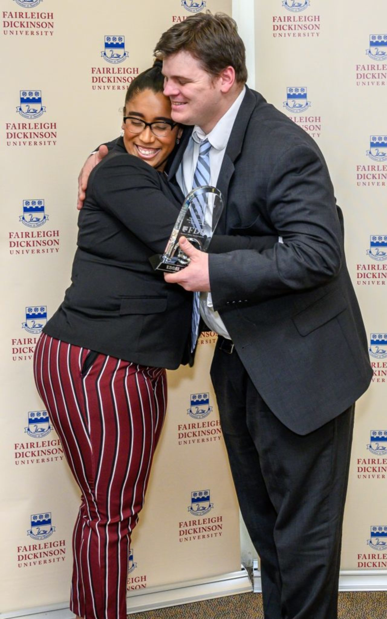 Nina Marie Disla hugs her high school teacher Eddie Baldwin