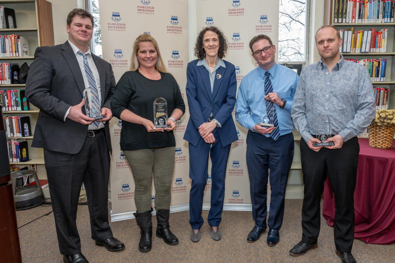 Four high school teachers with awards