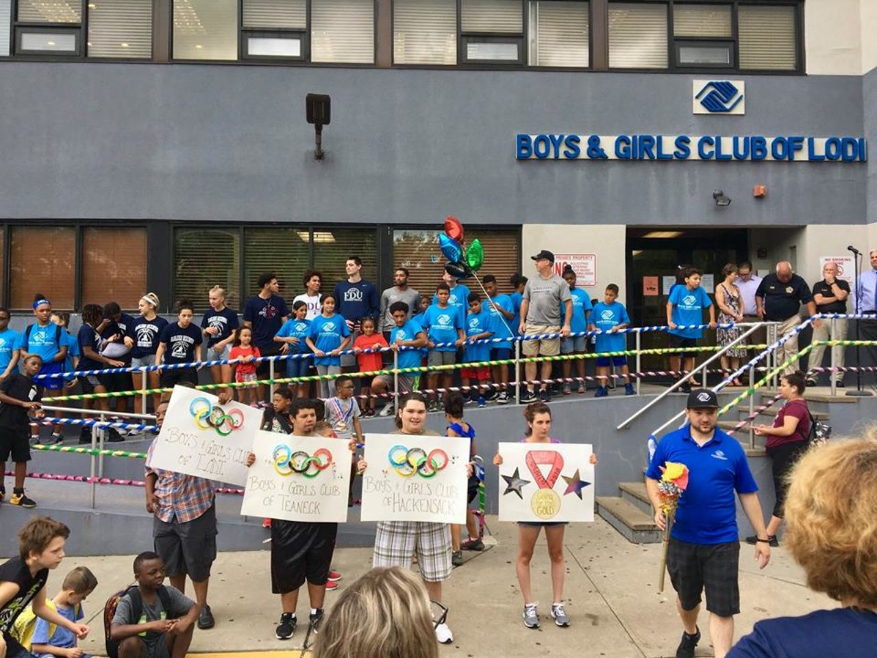 """students holding """"Boys and Girls Club"""" signs"""