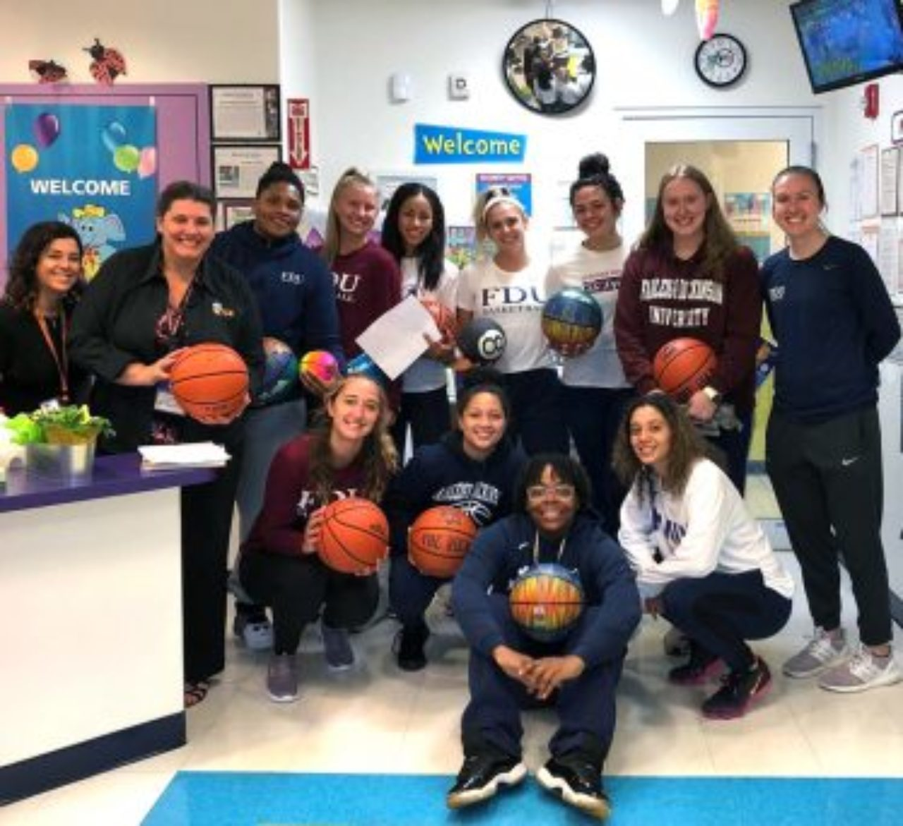 The Knights women's basketball team volunteers at the Learning Experience