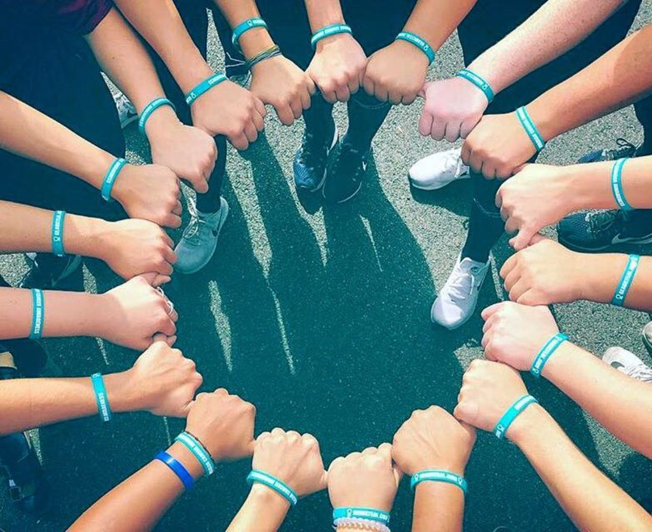 Knights softball team links hands with matching bracelets