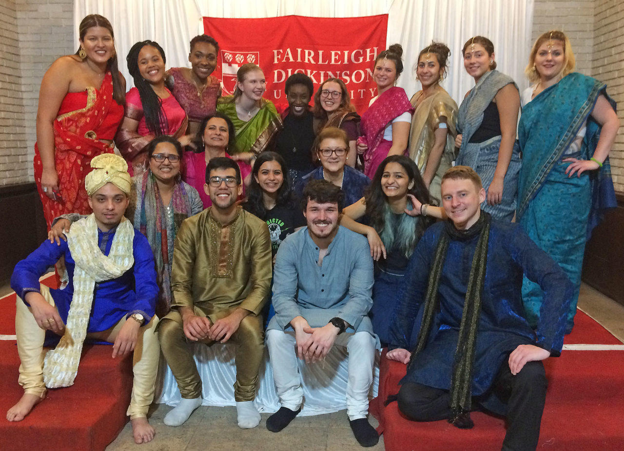 students and faculty wearing pieces of traditional Indian clothing