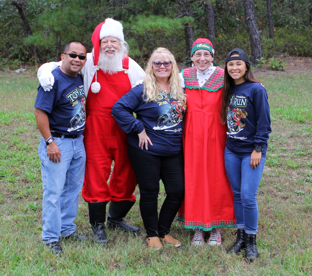 Jarin family with Santa Claus and Mrs. Claus