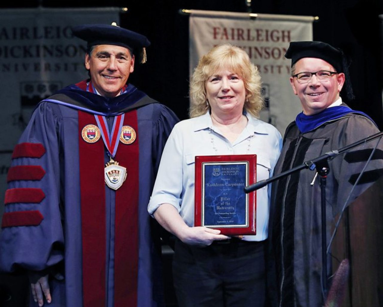 Katie Carpenter, flanked by University President Christopher Capuano and Florham Campus Executive Brian Mauro, was honored as a Pillar of FDU