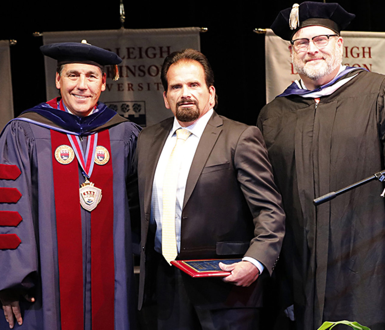 Michael Noe, flanked by University President Christopher Capuano and interim Metropolitan Campus Executive Craig Mourton, received the Pillar of FDU award