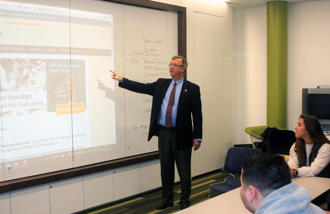 Professor Cleaves speaks to students