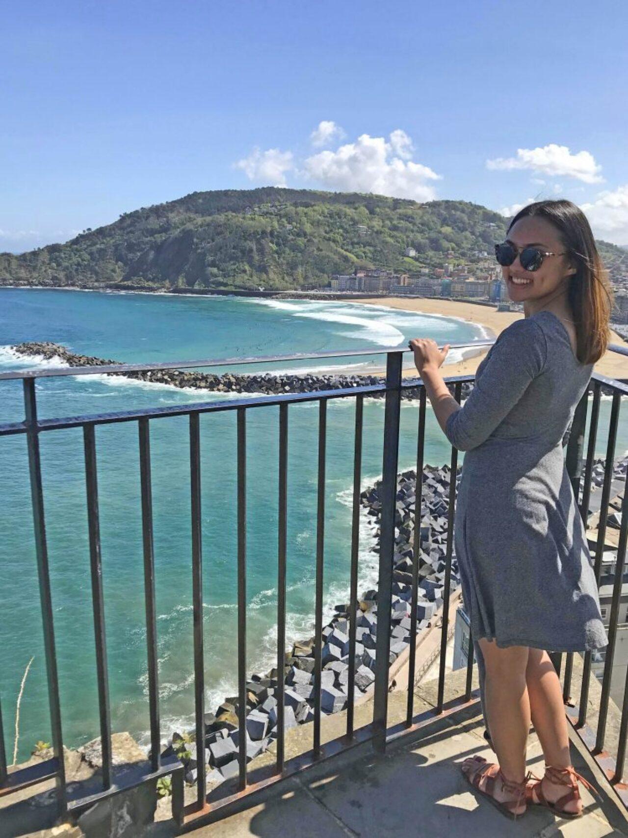 Ediza Koch on balcony looking over ocean