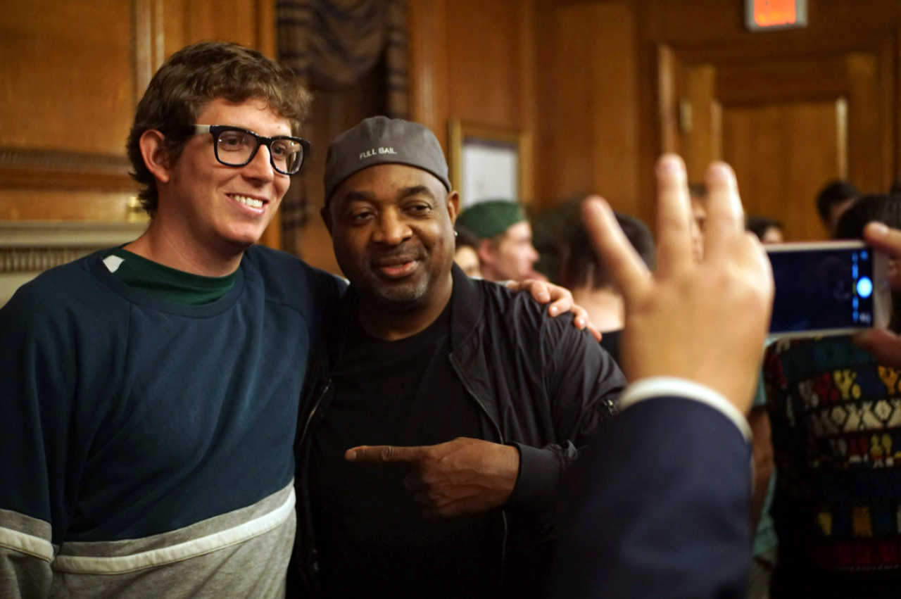 A student poses for a photo with Chuck D. (Photo by Ryan Silva)