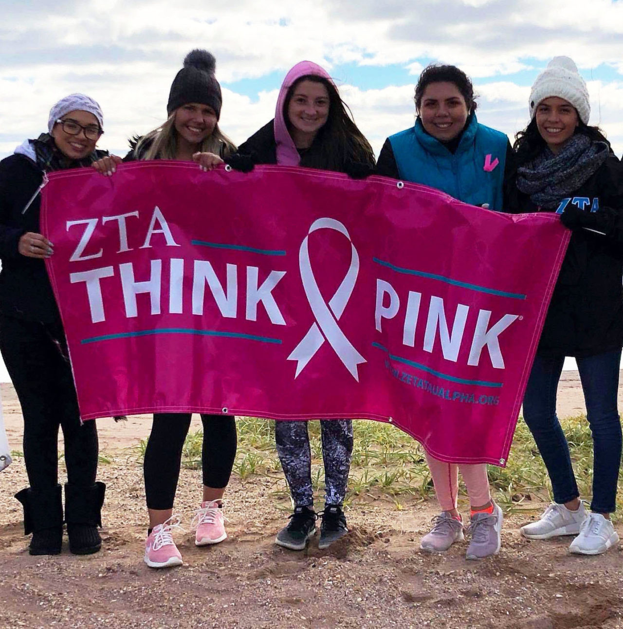 """five girls with """"Think Pink"""" sign"""