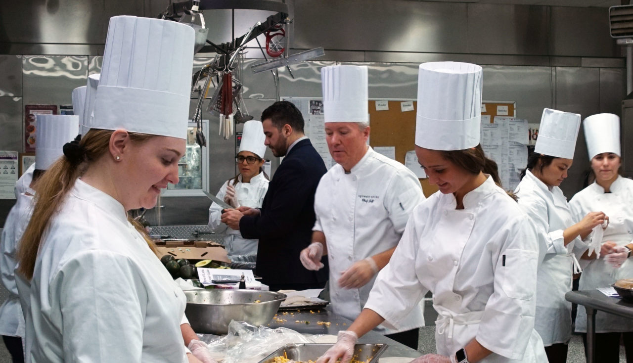 Chef Jeff Gourley of the Florham Campus Dining Hall teaches hospitality students how to prepare food