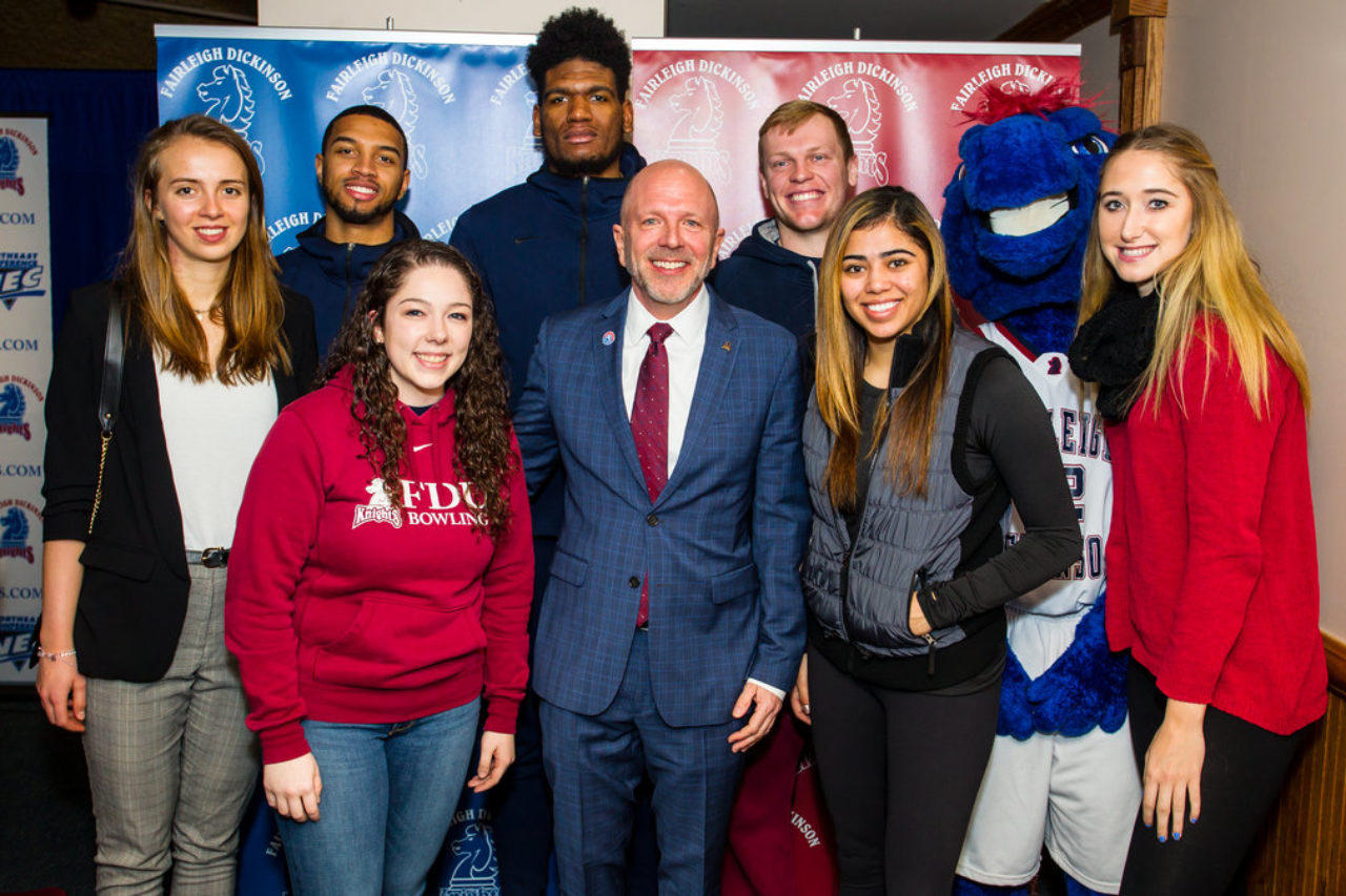 Hurlbut with several student-athletes.