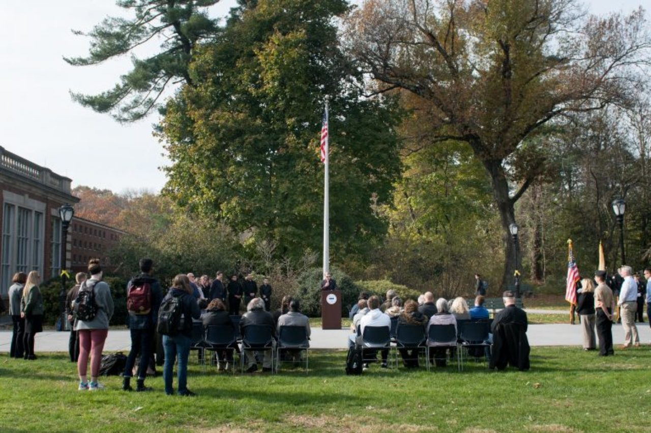 Graduate student veteran Joel Adams delivers the keynote address at the Florham Campus Veterans Day ceremony.