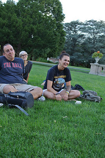three people sitting in the grass