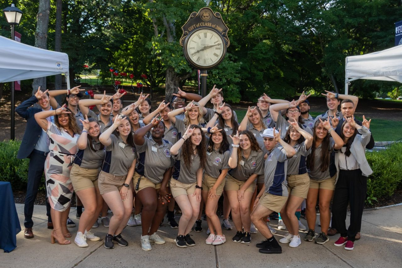 Group of students display the FDU horns.