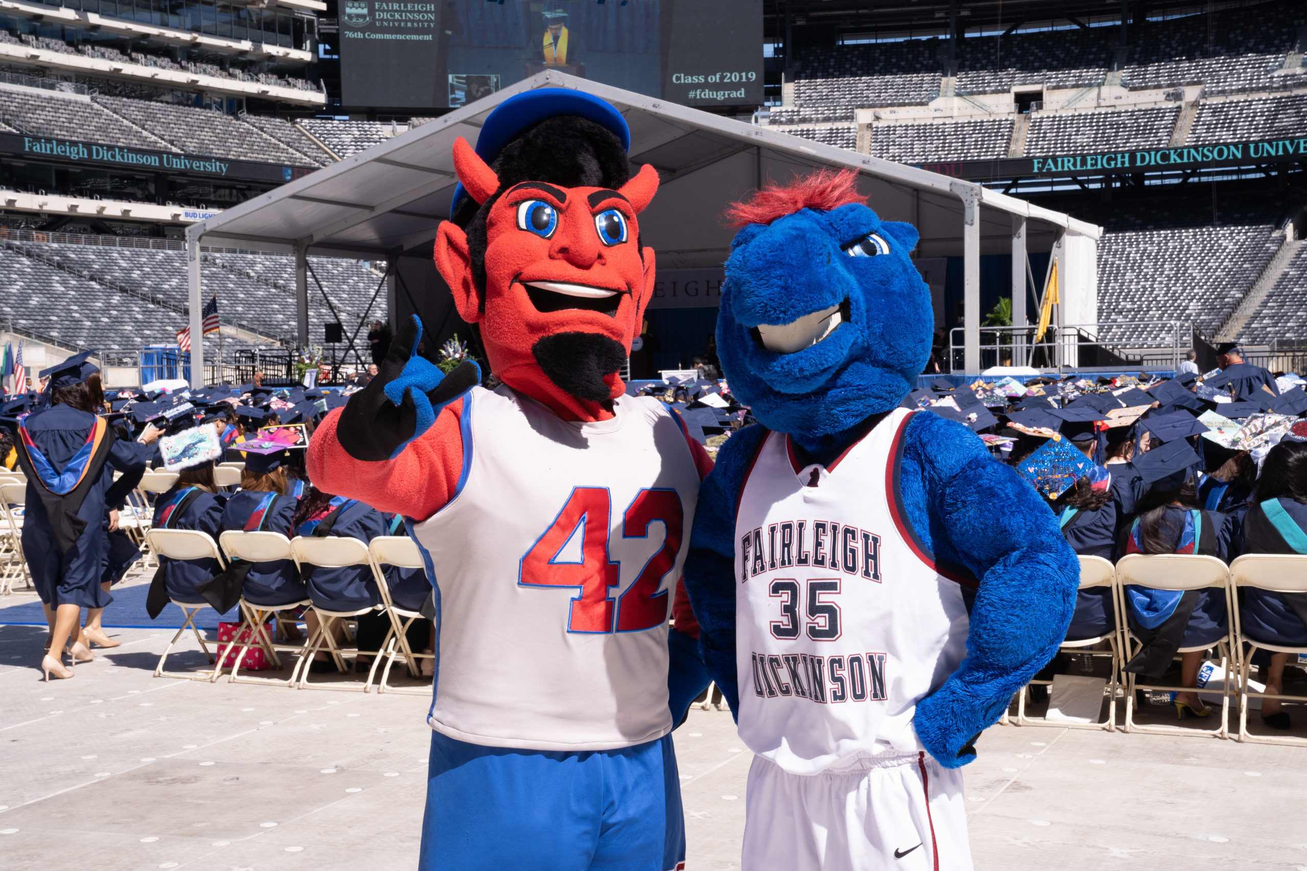 FDU mascots Ian the Devil and Knightro pose for a photo