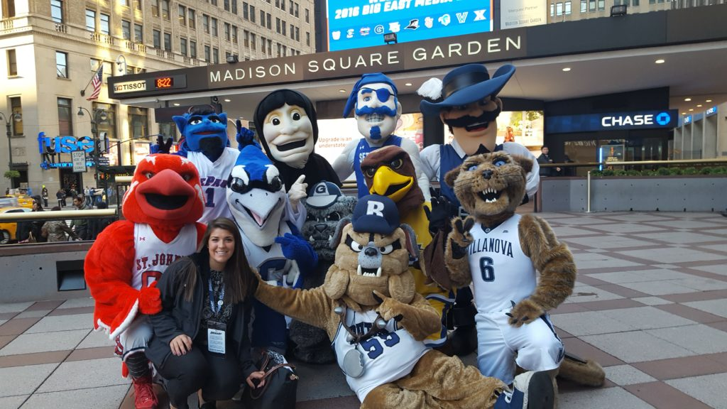 Alumna Cat Krawiec with mascots from the Big East Conference in front of Madison Square Garden