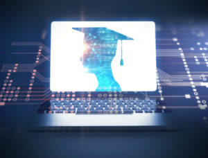 A graduate on a laptop computer screen wearing a graduation cap with a computer board background.