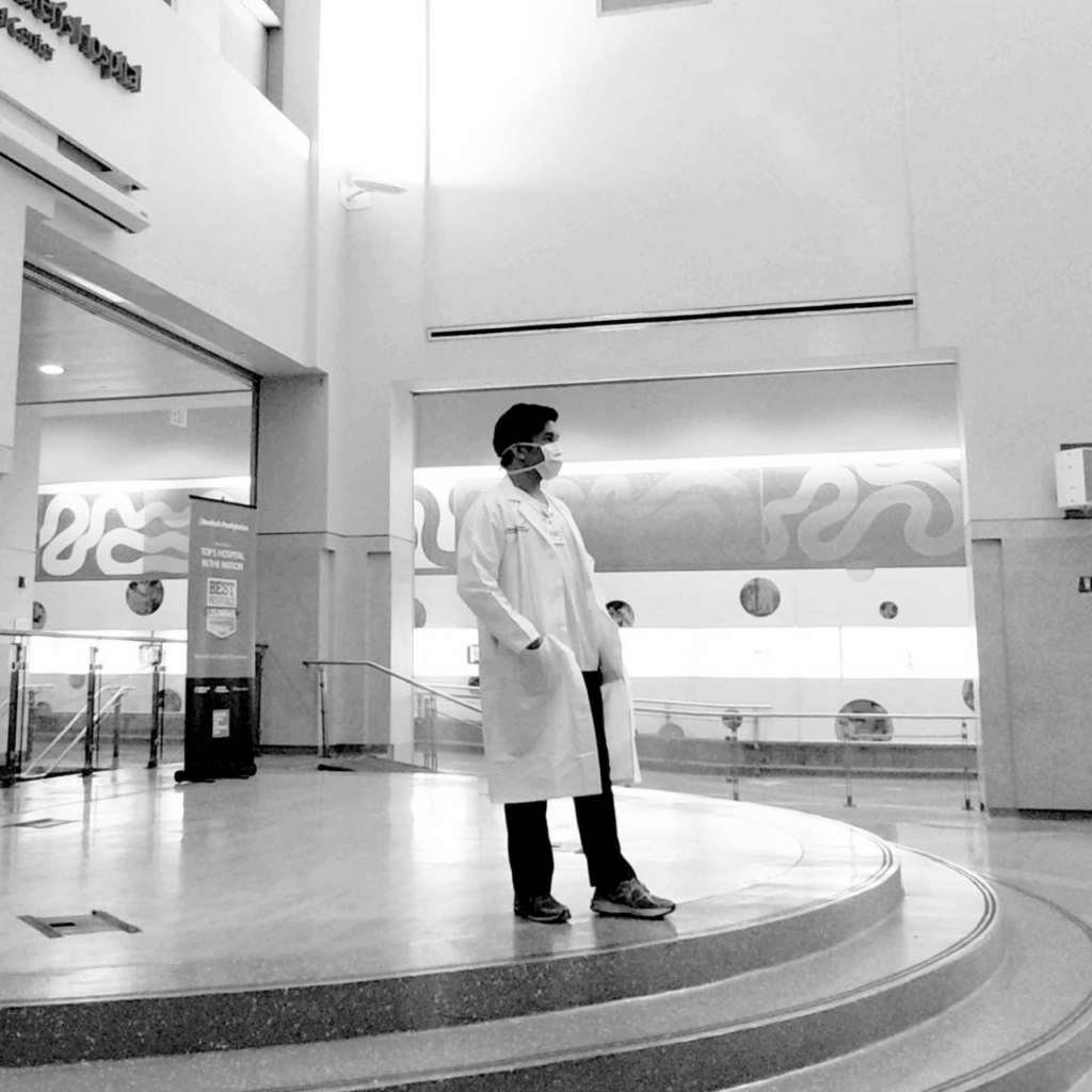 Lester Castor stands and observes a quiet moment in the hospital he works at.