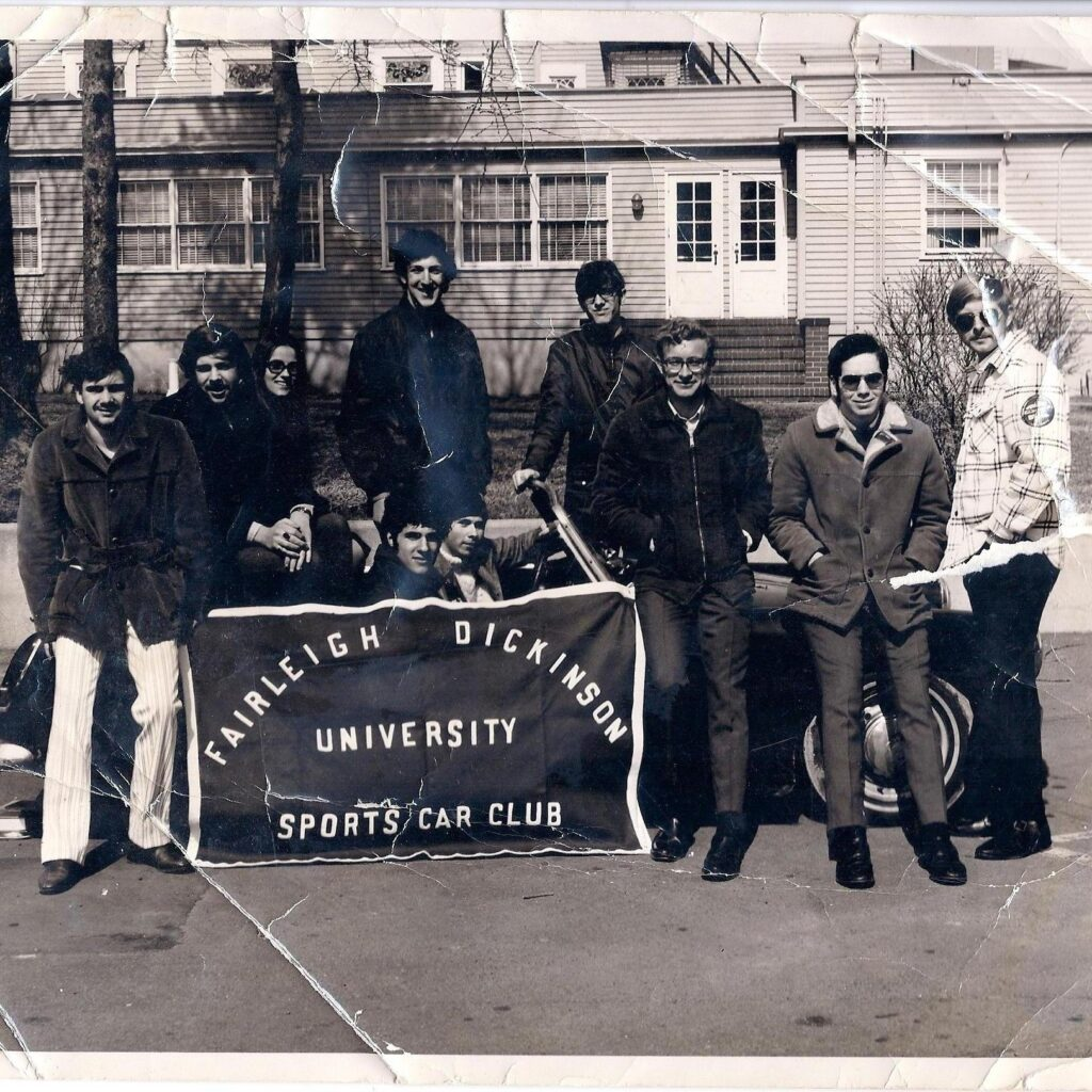 A photo of some of the members of the sports car club from the 60s.