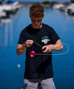 Kevin Weller shows off his impressive yo-yo skills in front of a lake.
