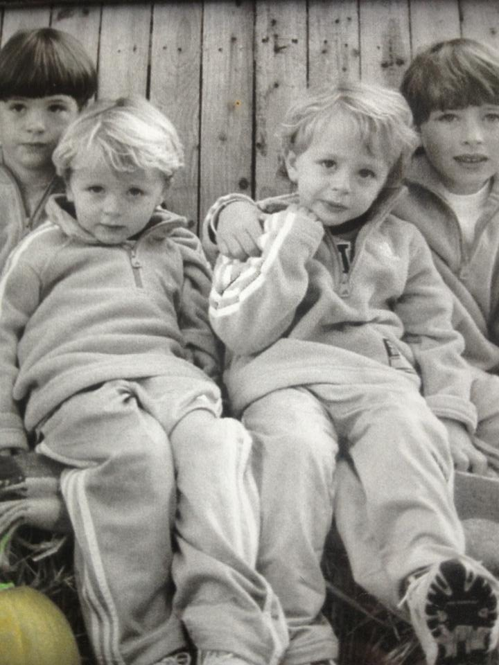 The four young Stewart brother pose for a photo in matching clothes.