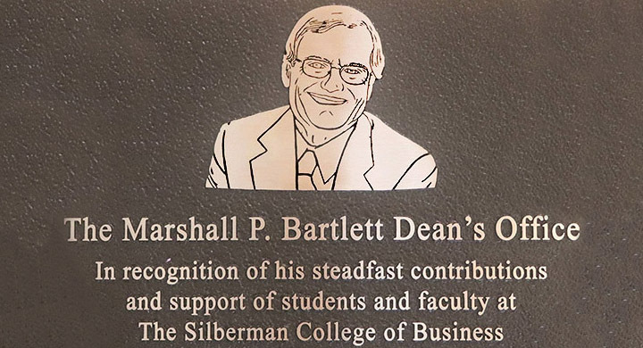 A photo of the plaque featuring Marshall P. Bartlett and his name.