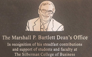 The plaque honoring Marshall P. Barlett, the Silberman College of Business dean's office has been named for him