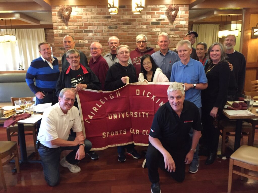 The Fairleigh Dickinson University sports car club posed together for a photo during their reunion in 2019.