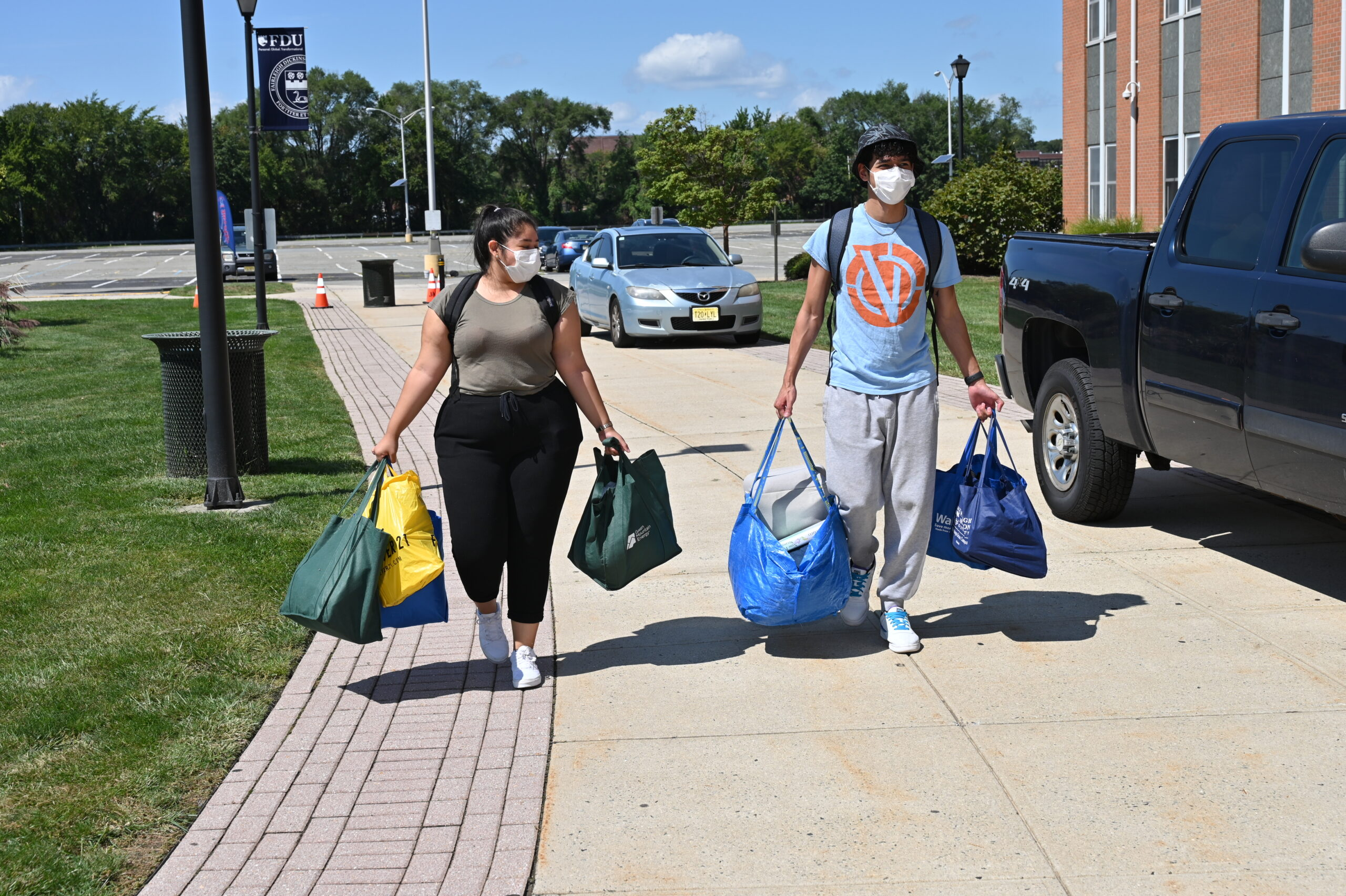 Students carry items.