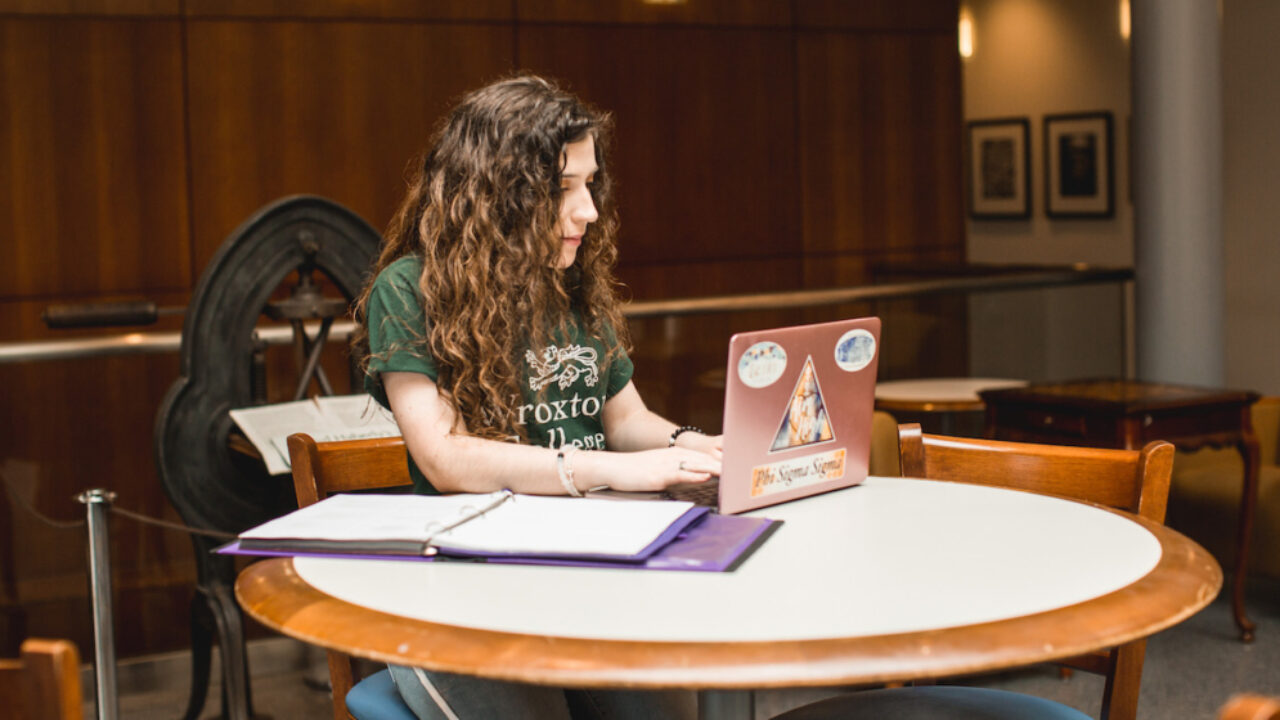 A student works on a laptop