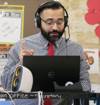 Angel Santiago in his classroom teaching virtually.