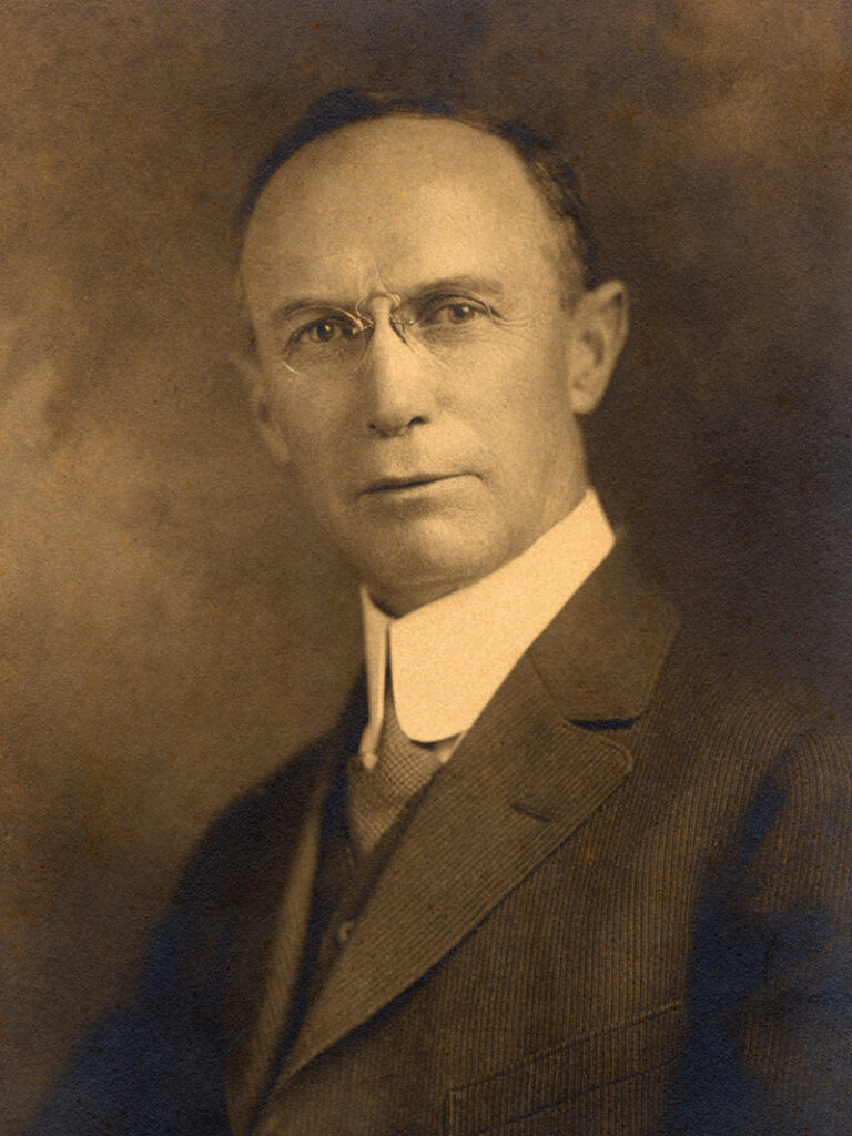 A vintage portrait of a man, circa the early 1900s.
