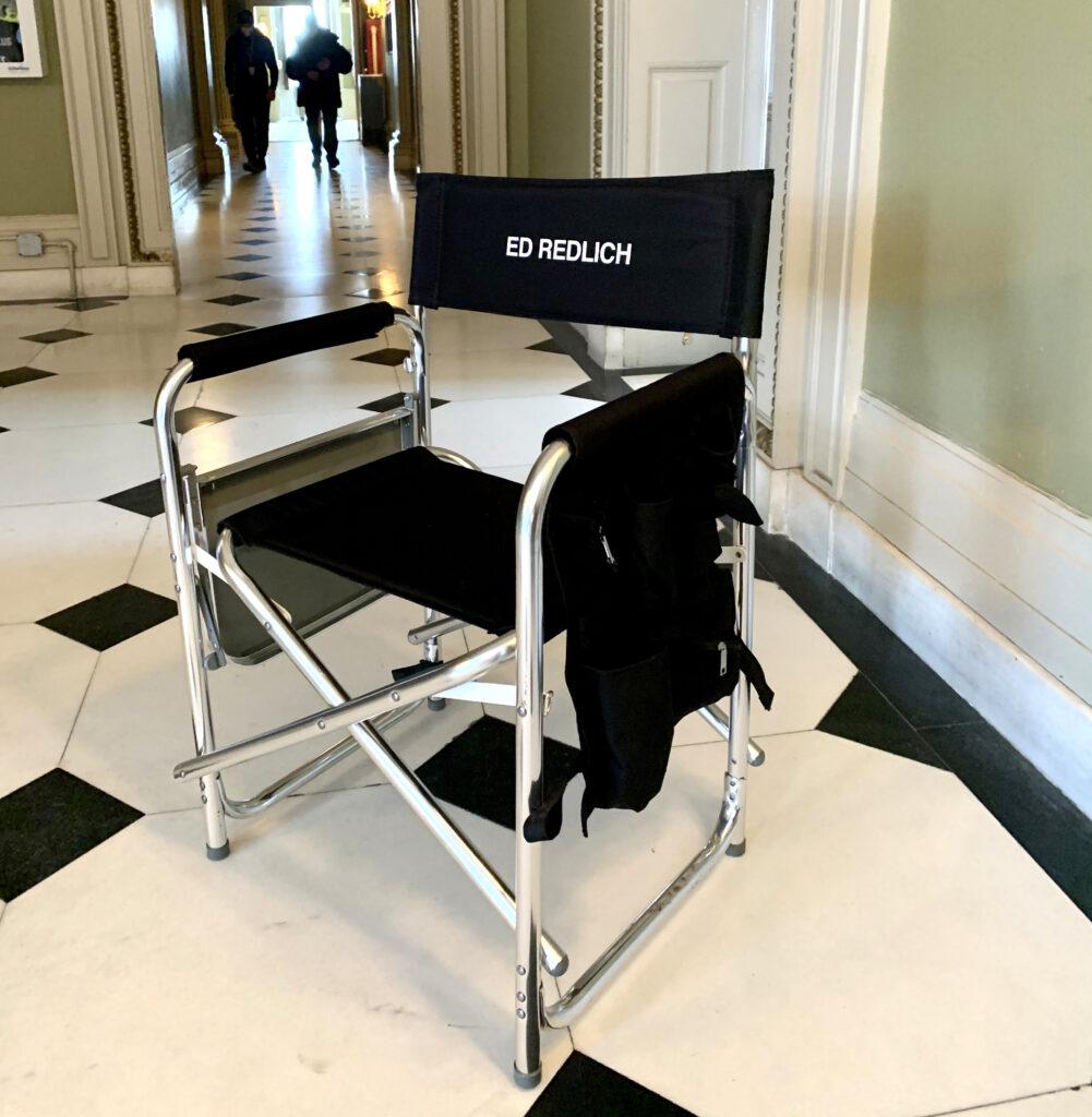 """Chair that reads """"Ed Redlich."""""""