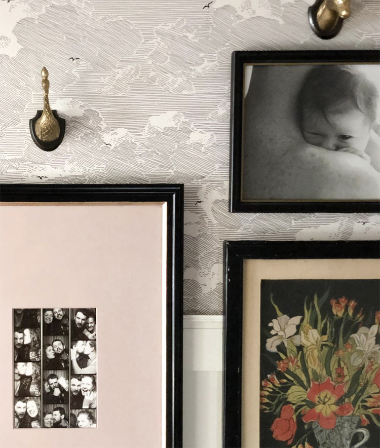 A photo wall with family pictures and flower art.