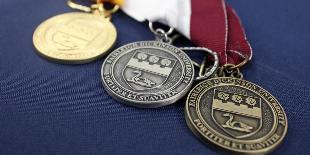 A close-up of FDU graduation medals.