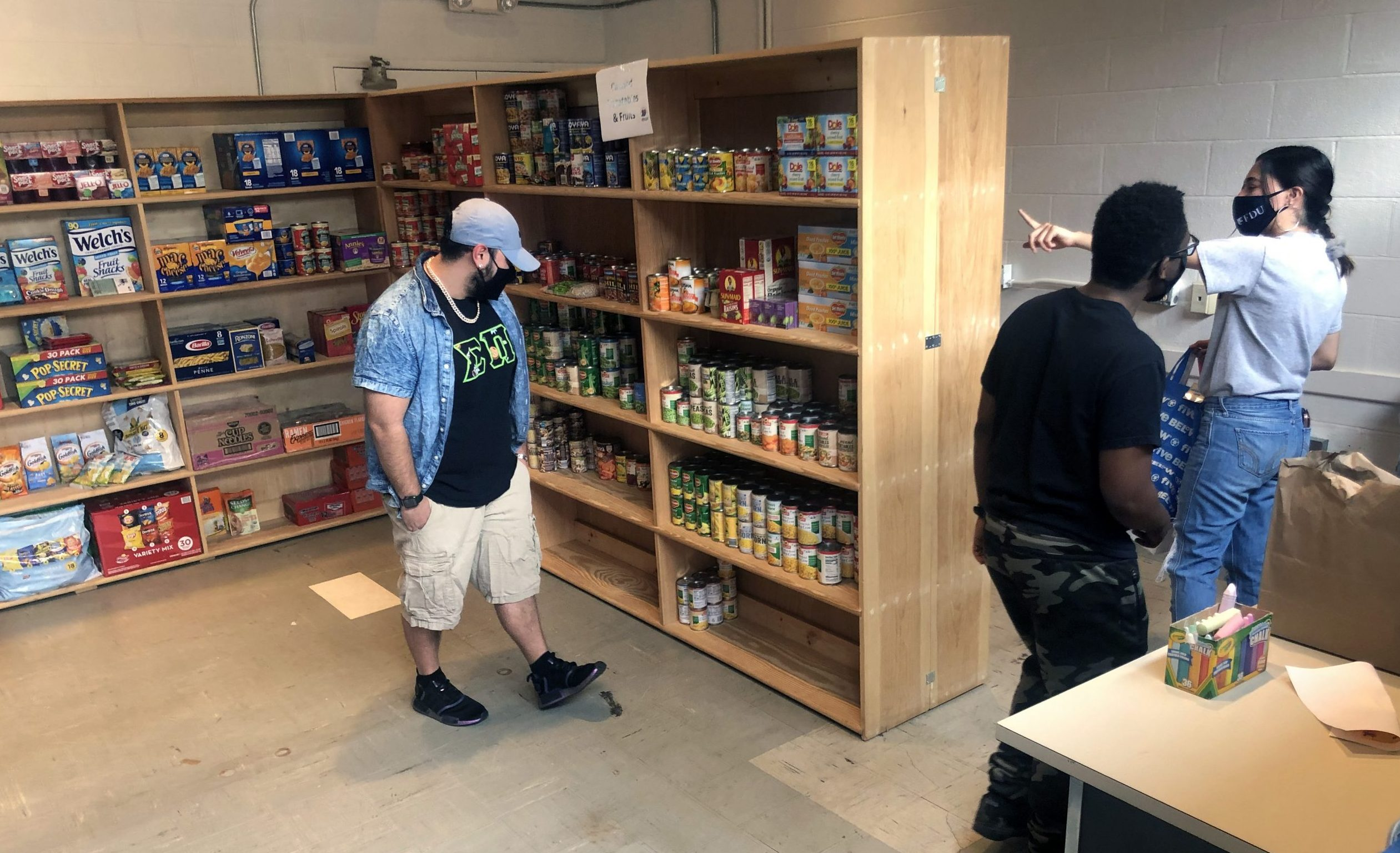 Students help stock the shelves.