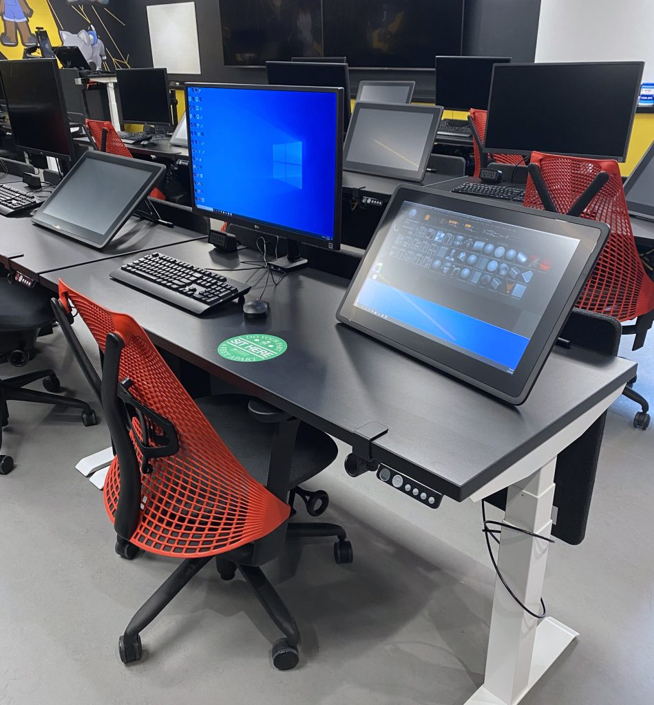 A workstation for a student animator, complete with two computer monitors, including a drawing tablet.