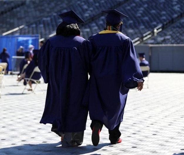 Smart and Burr walk together.