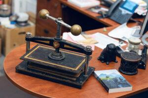 A bookbinding press atop a desk.