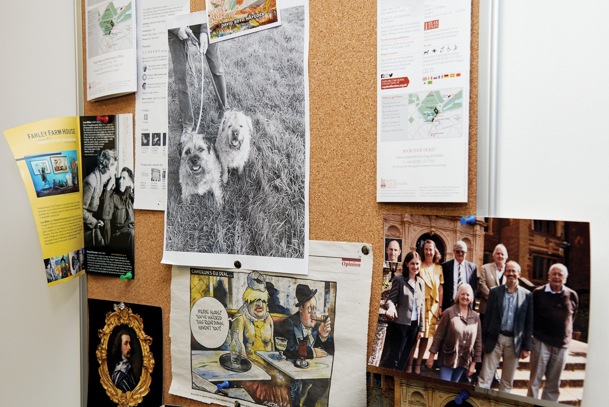 A bulletin board with a smattering old photos and newspaper clippings.