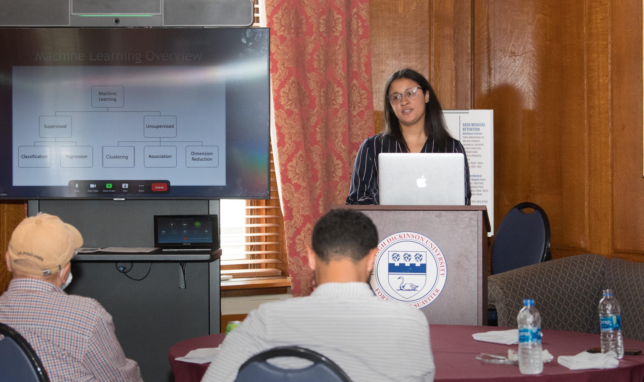 A student speak at a podium.