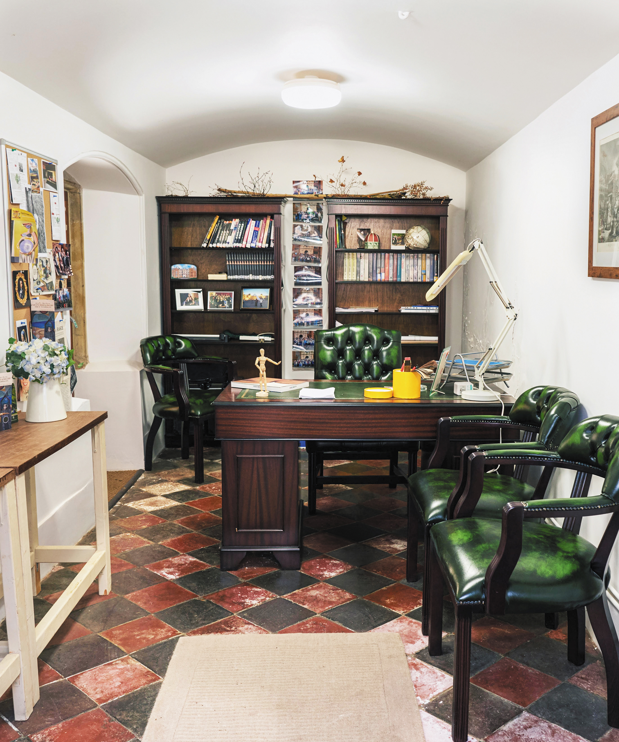 A full view photo of a unique basement office space.