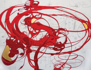 A piece of art with layers of red paint mingling with splashes of black and gold leaf on background of white.