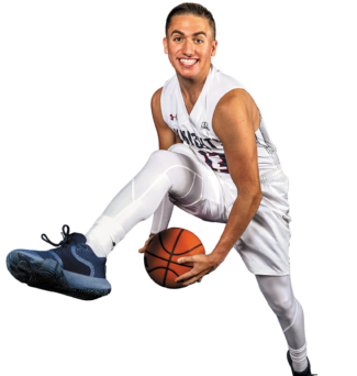 Basketball player holding a ball while jumping